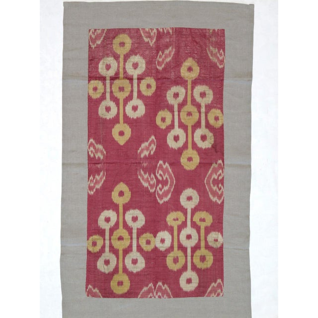 A beautiful antique textile from Uzbekistan in Central Asia, a fragment from a larger panel woven in silk ikat technique....