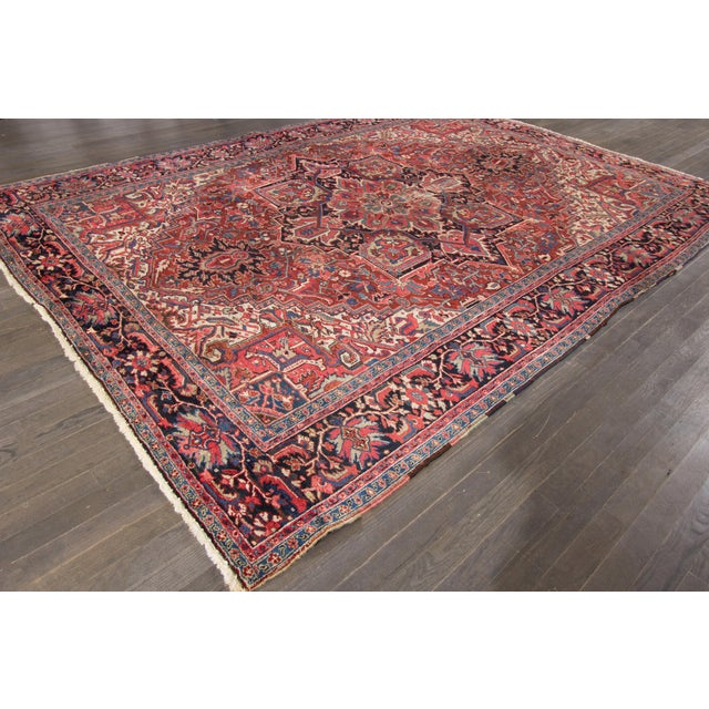 Vintage hand-knotted Persian rug with a medallion design on a red field, this rug has pristine detailing and is ready for...