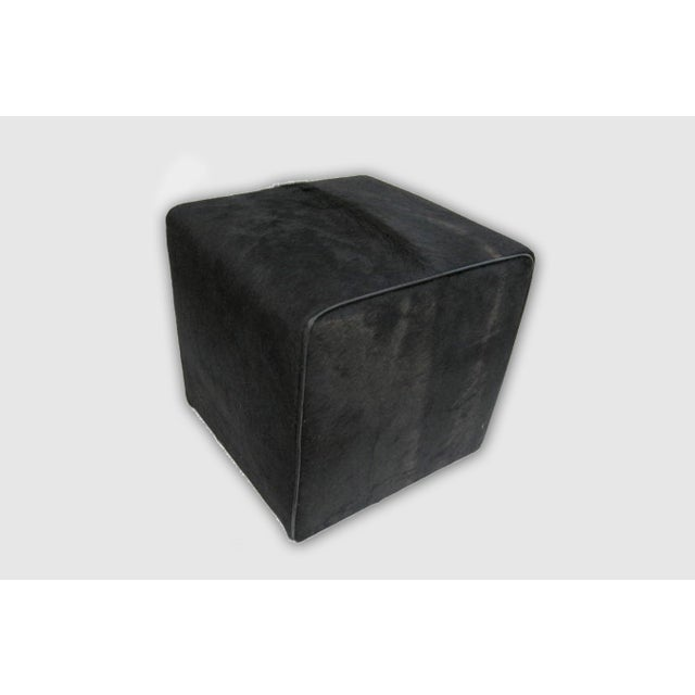 Waterfall Ottoman, Black. Hair on hide Please allow 4 weeks before the item ships.