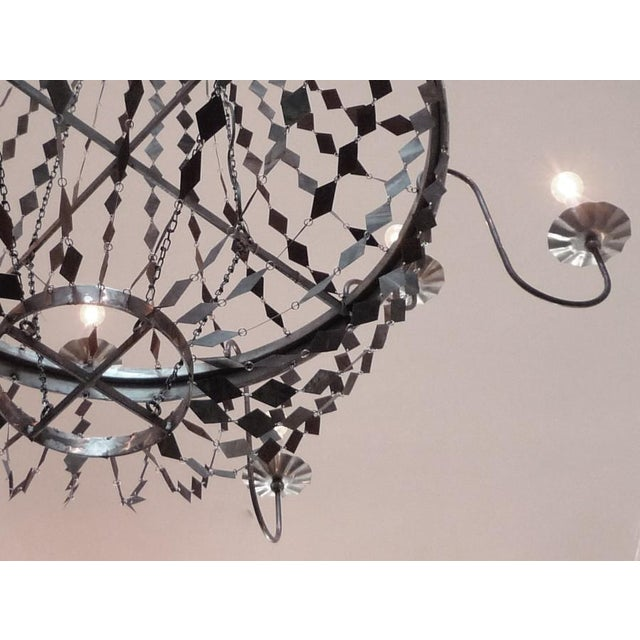 this one of a kind chandelier is huge and absolutely stunning. this fixture was made custom from reclaimed metal pieces...