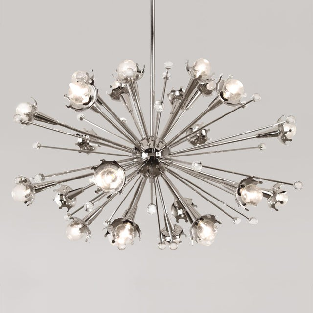 Original Jonathan Adler piece in excellent condition. This beautiful chandelier proudly stood guard over our reception...