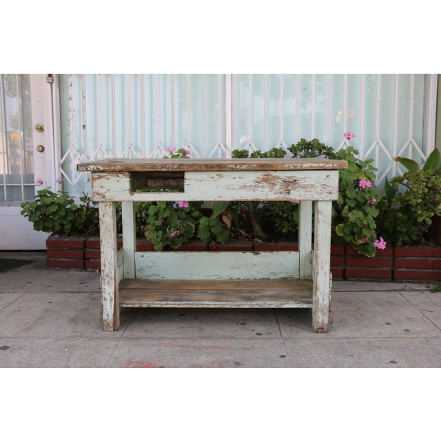 Vintage wooden distressed farm table in good condition. It is missing a drawer, the base is sturdy and well kept. Top is...