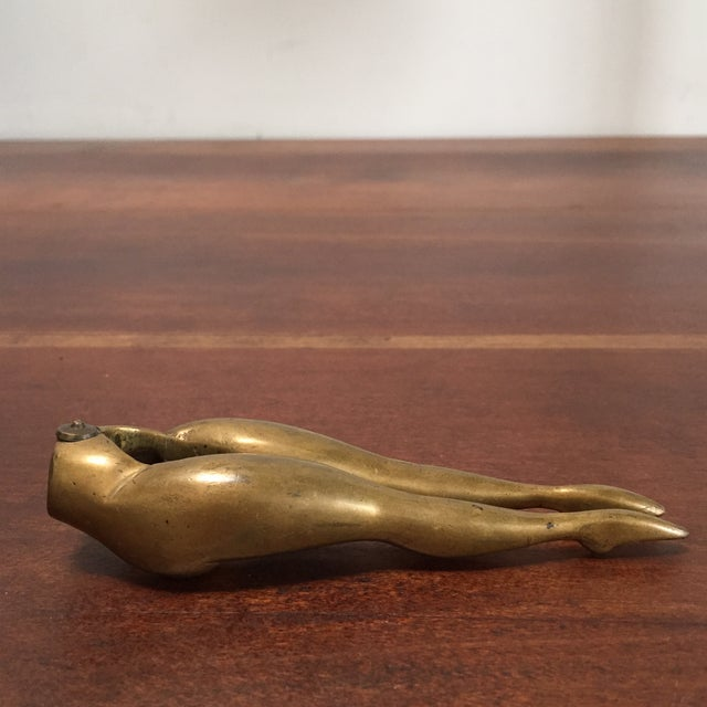 Add a little humor to your entertaining with this vintage brass legs nutcracker. The nutcracker's shapely design will...