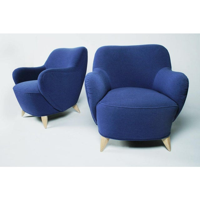 A mid-century modern, classic barrel chair, originally designed in the 1940's, with wing like arms that attach to the...