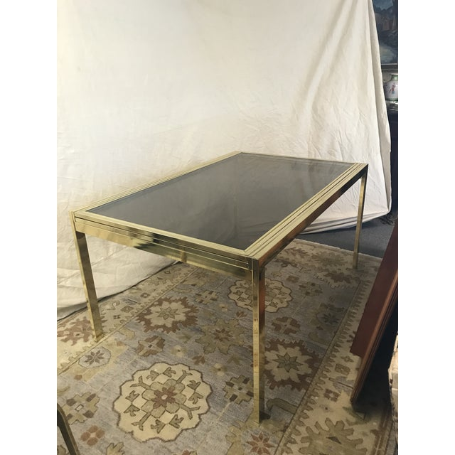 Design Institute America modernist glass-top dining table with extending leaves and brass frame. A Milo Baughman design....