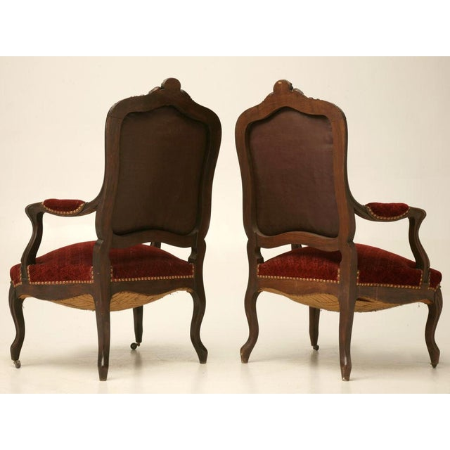 Extraordinary pair of antique French hand-carved walnut Louis XV fauteuils. This fine might need restoration but, look at...