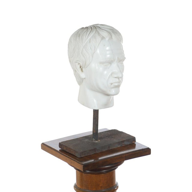 We love the thought of this antique, carved marble, Roman Emperor head being situated in an entry, ready to catch summer...