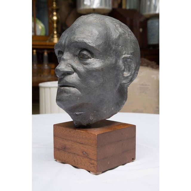 This detailed solid lead sculpture by Charles Watson, 1974, is an impressive bust of a gentleman situated on a walnut...