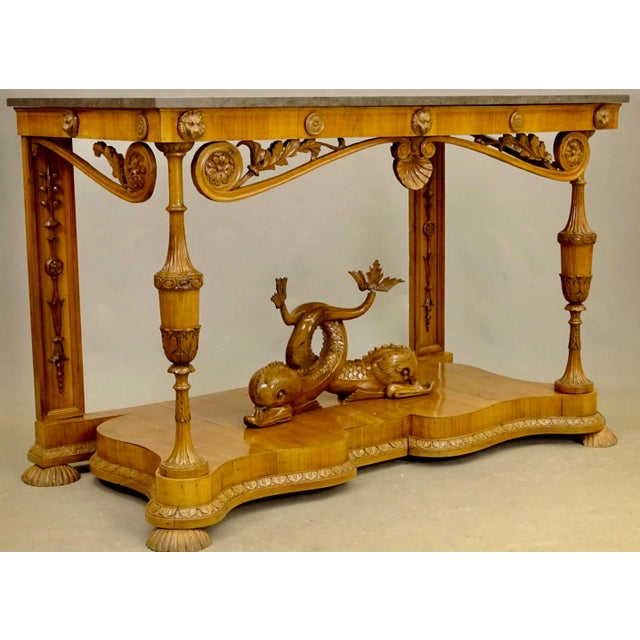 Whimsical, neoclassical German Biedermeier console with later German sandstone top. Beautifully hand carved, with entwined...