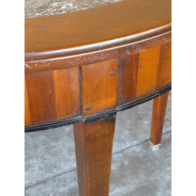 the handsome table with marble top, the apron fitted with 4 candle slides; good solid construction with hand-made wooden...