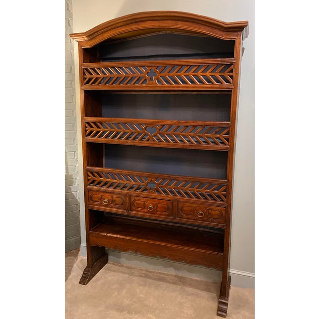 18th-century French marriage bookcase with three drawers and three shelves with carved wood fronts with club, heart and...