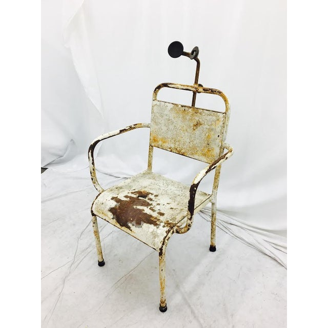 "Curious and funky, antique medical chair. Rusted white painted finish. Seat is approx 17.5"" H."