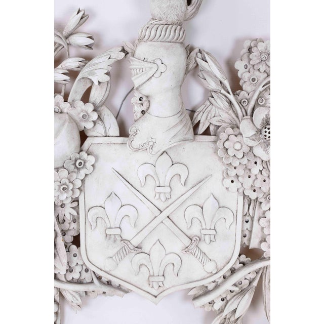 This Grinling Gibbons-inspired wooden carved family crest depicts two crossed sword and four fleur de lis. Accompanied by...