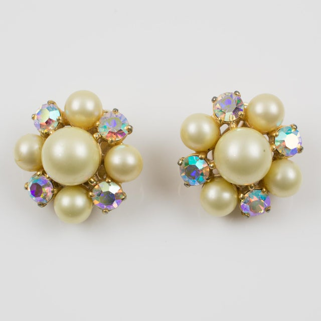 Lovely 1960s clip on earrings by Elsa Schiaparelli (1890 - 1973). Featuring geometric floral design with gilt metal...