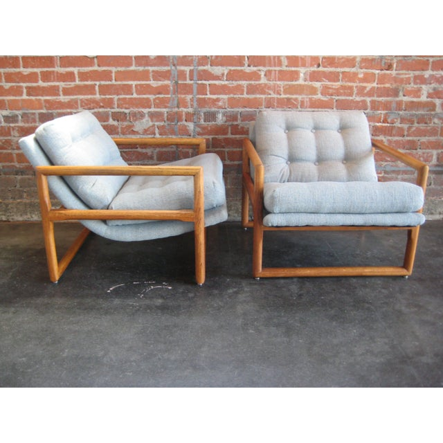 Two cube frame chairs with upholstered scoop seats. They have recently been upholstered in a grey-blue tweed with dark &...