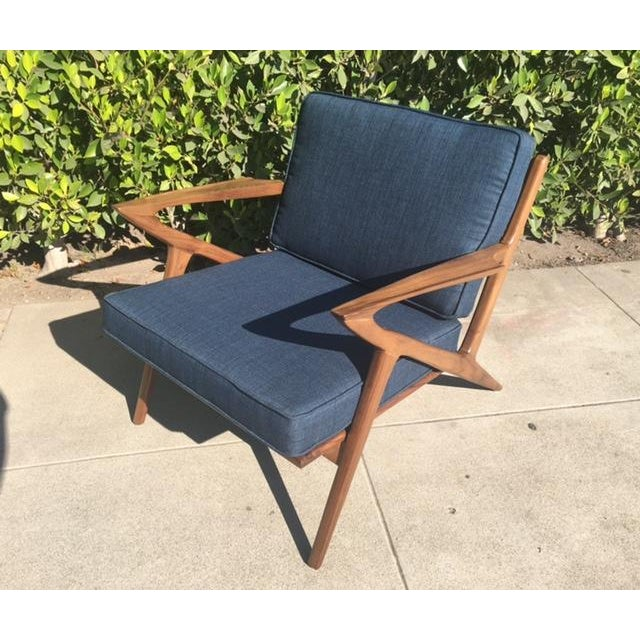 """A stunning Mid-Century Modern-style """"Z"""" lounge chair constructed of solid walnut. A sleek design with excellent..."""