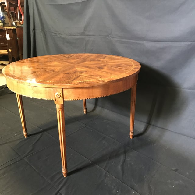 Gorgeous French inlaid round marquetry table with beautiful circular block pattern surrounding the burled walnut center....