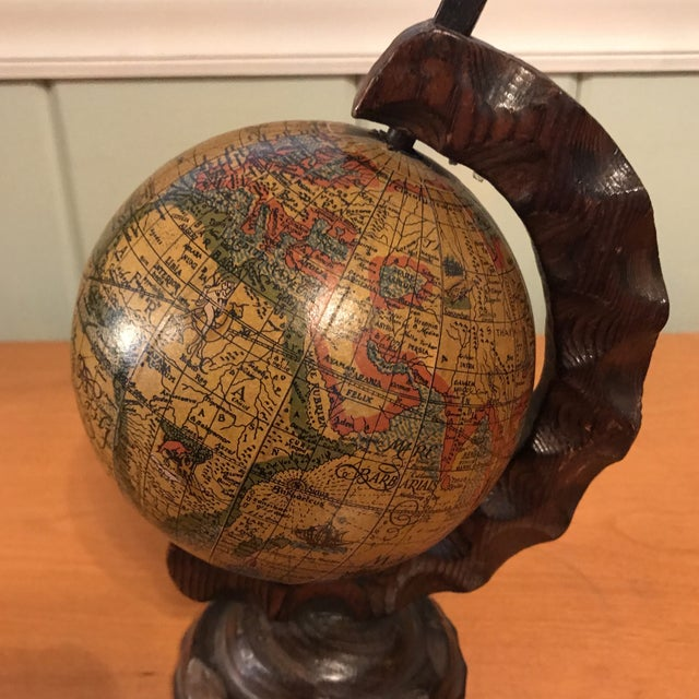 Add some worldly flair to your office or library with this mini globe! The thick walnut wood is carved to give it a richer...
