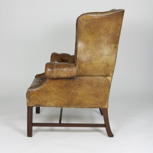Georgian An Elegant Brown Tufted Leather and Mahogany Wing Chair with Tight Seat; English Circa 1860. For Sale - Image 3 of 13