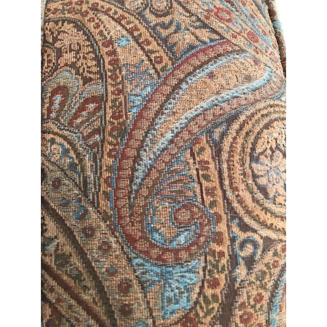 Vintage Mid Century Paisley Upholstered Ottoman by Sherrill Furniture. In excellent condition. Wooden legs sit atop metal...