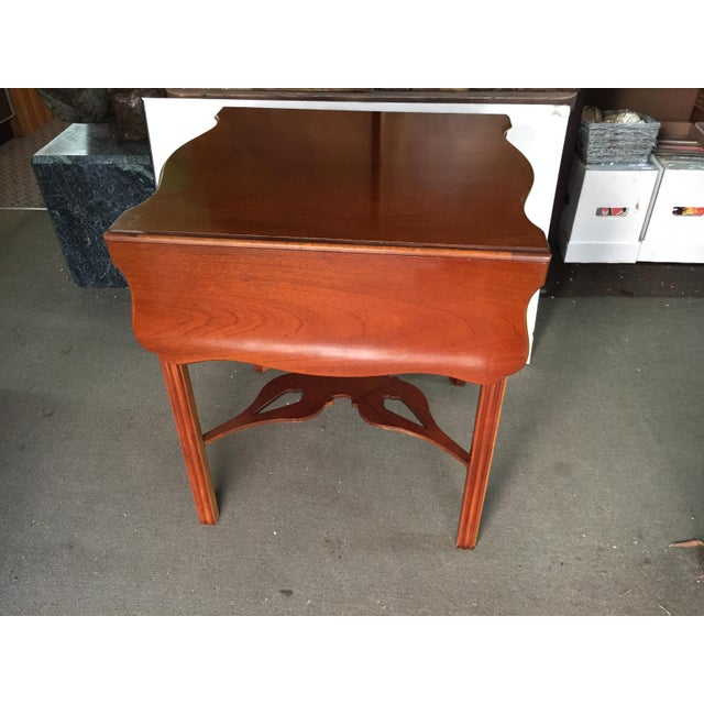 Baker Furniture Side Table. Historic Charleston Collection. In excellent condition. It is slightyly faded on one end from...