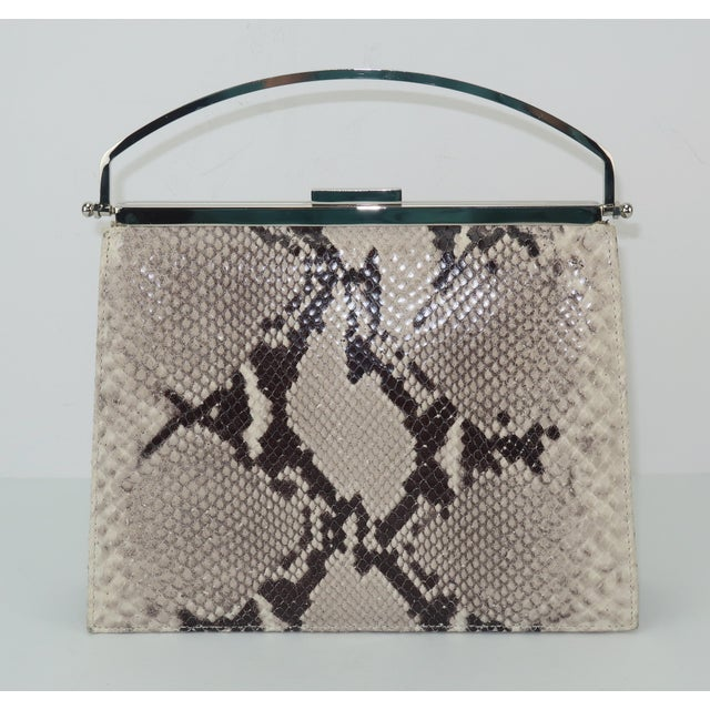 Get the python look with this stylish handbag created under the Neiman Marcus label. The 1980's design pays homage to the...