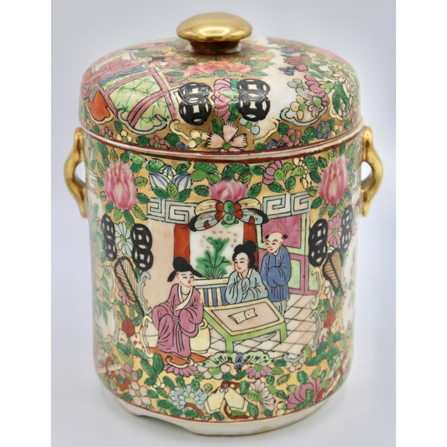 A lovely Famille Verte Chinese Rose Medallion jar. Carries the mark of the Qing Dynasty, Qianlong Period (1736-1795). This...
