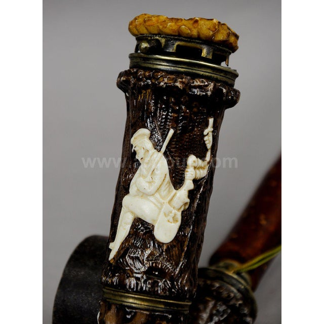 a hunters pipe made of porcelain. with surface-mounted hunting scenes like stags, wildbirds, hunting dog and a poacher...