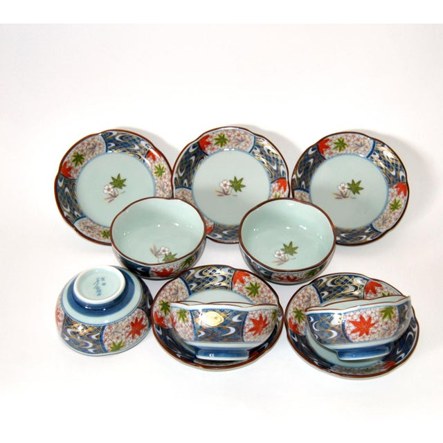 Unique Japanese Arita-Imari five-cup and saucer set, celadon porcelain, with display cabinet in lacquered wood. These...