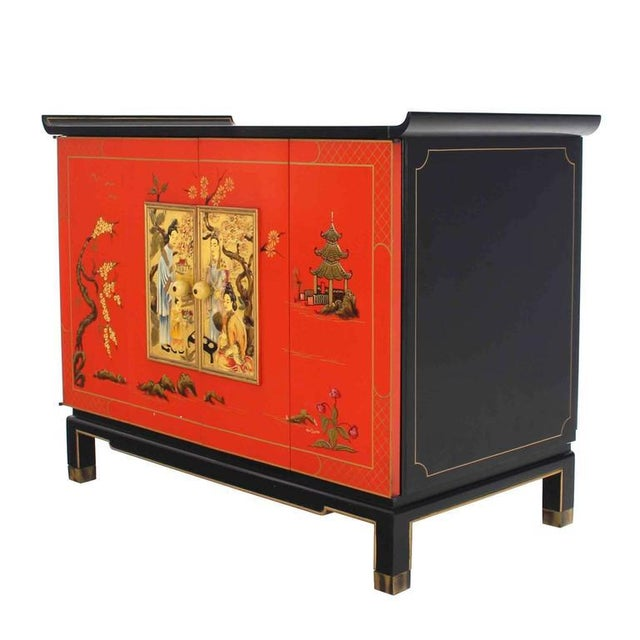 Very nice black lacquer cabinet with two oriental motive decorated accordion style doors. Made in the mid 20th century.