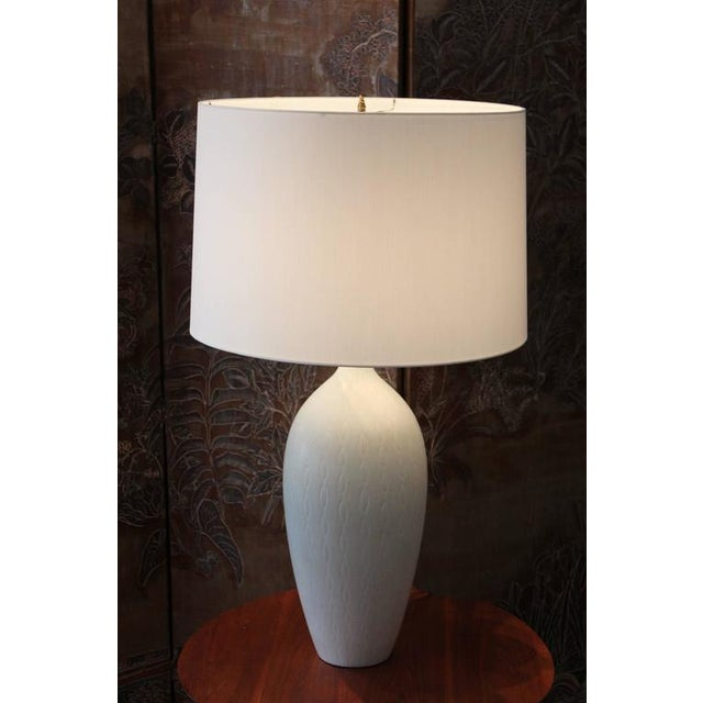A beautifully glazed Swedish table lamp by Carl Harry Stalhane for Rörstrand. Rewired with new silk shade.