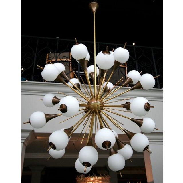 1960s Italian Sputnik chandelier with 30 lights encased in opaque glass balls.