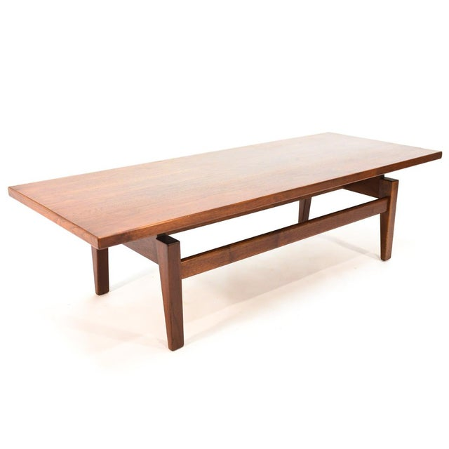 Walnut coffee table designed by Jens Risom. Beautiful piece, utilizing some fantastic walnut as most of his pieces did. A...