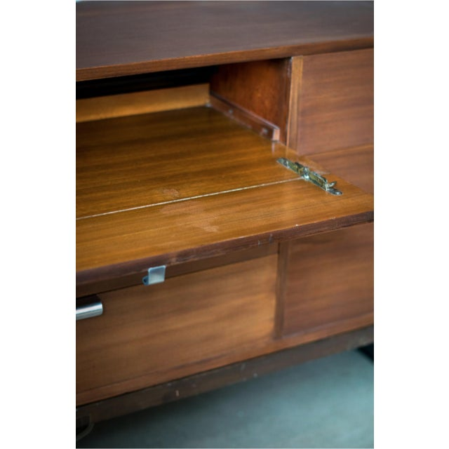 "The ""Hotel"" chest, in Prima Vera walnut designed by George Nelson for Herman Miller Furniture Company (1948) set atop a..."