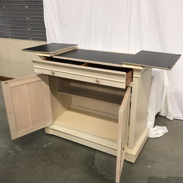 Ethan Allen flip top server bar in a white stain. Great size and modern look! Wheels for easy moving.