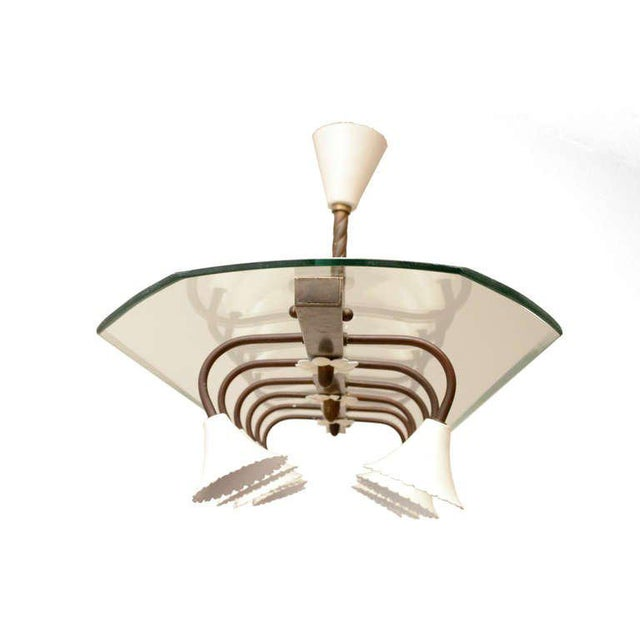 For your consideration a vintage Italian chandelier constructed with brass, custom glass and twelve aluminum shades in the...