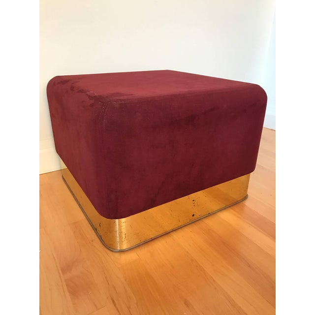 Pair of burgundy suede stools with patinated brass base by Milo Baughman for Thayer Coggin.