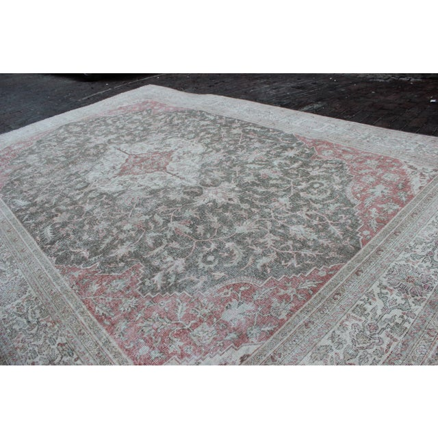 Vintage Turkish Sivas rug in hues of sage green, brick red and wheat. Made of wool, this rug has been shaved and hand...