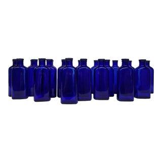 """Vintage """"Blue Coral Treatment"""" Glass Bottles - Set of 12 For Sale"""