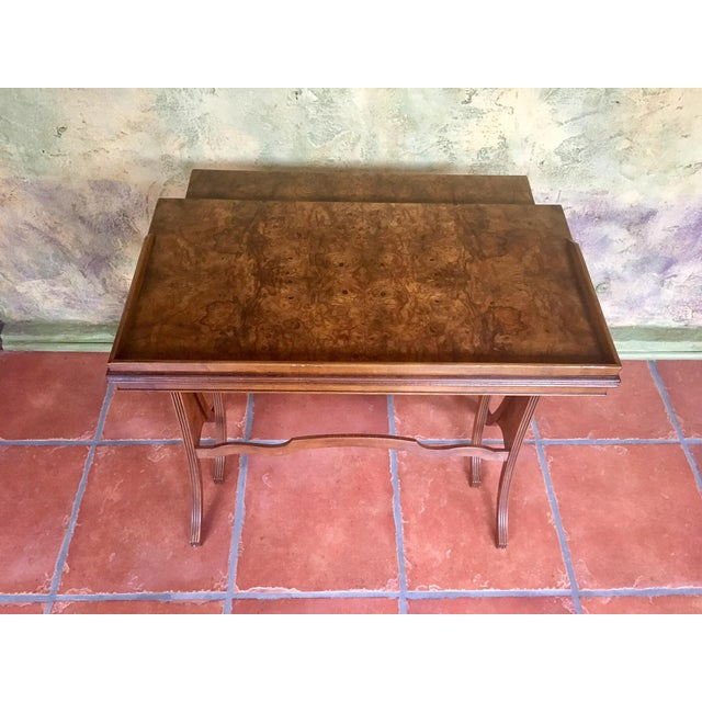 Absolutely gorgeous set of vintage nesting tables by Baker Furniture featuring stunning burled walnut veneer tops, gently...