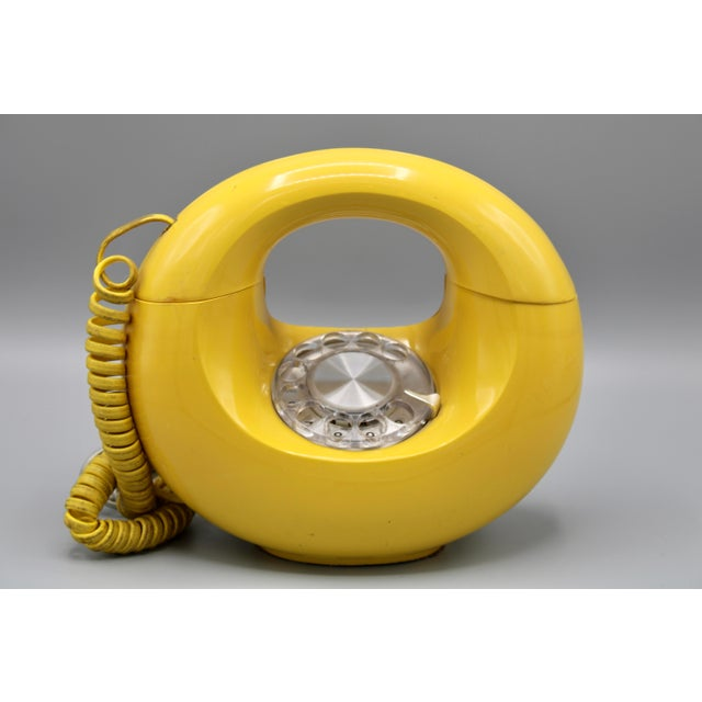 A superb Art Deco Style Lemon Yellow Rotary Telephone, circa 1970. In working condition, ready to plug in and make a...