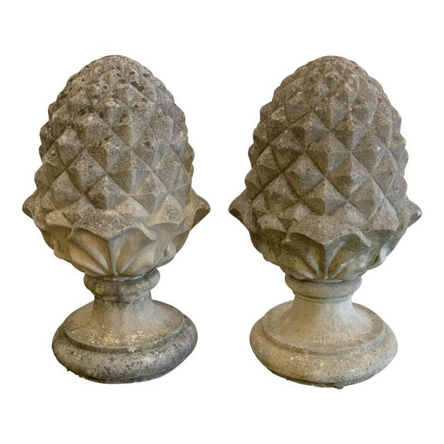 A fine pair of large English garden ornamental finials of composition stone, each finial featuring a stylized design of an...