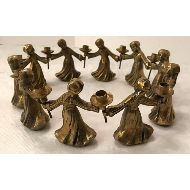 cute details of 10 ladies dancing candle holders. Each lady can be linked to another as shown. Nice natural patina!...