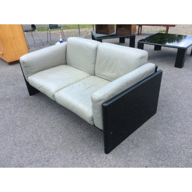 Grey leather settee (B) designed by Studio Simon and produced by Gavina. Settee is in great condition, with some wear....