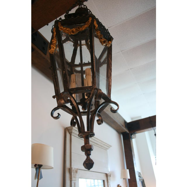 Lovely 3 light lantern with gilded swag design. Made in the style of Louis XV in the late 19th century.