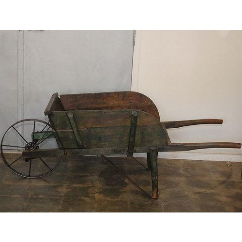 This dark green painted wheelbarrow came to us from Manchester, New Hampshire. At one time it was owned by John B. Varick...