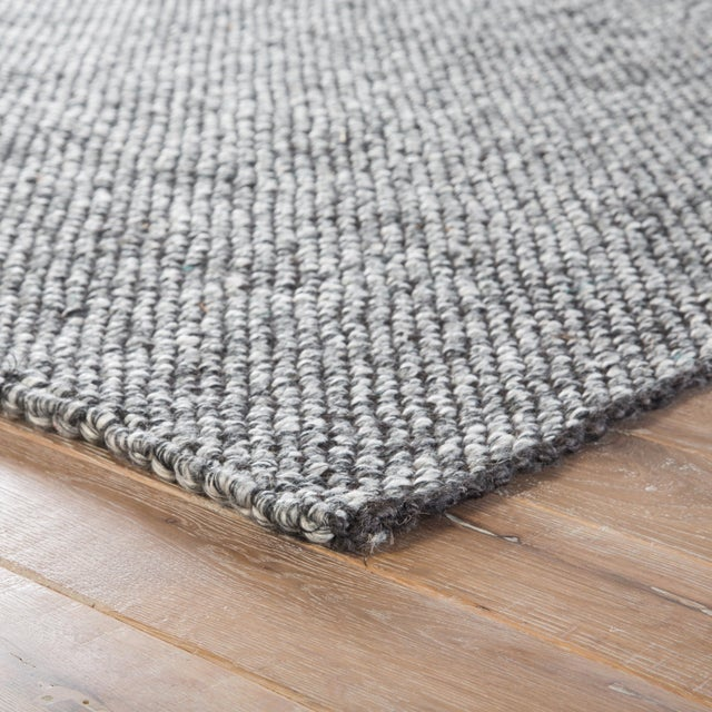 The gray Topper area rug from the Roland collection lends contemporary charm with a fresh twist on a natural accent. This...