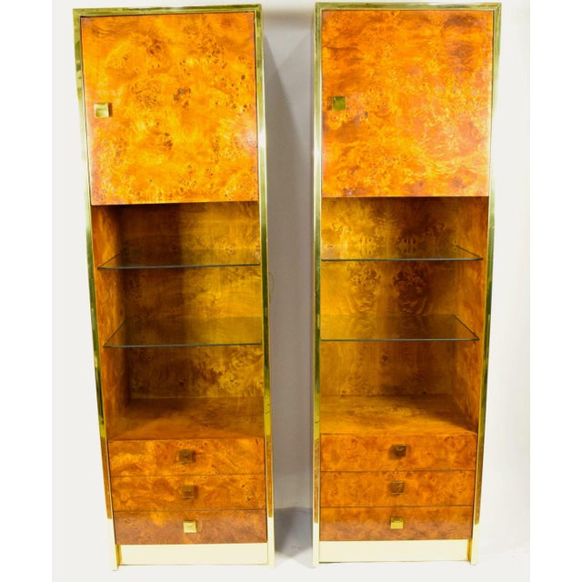 This is a gorgeous pair of Milo Baughman styled burled walnut shelf units by Founders (a division of Thomasville). They...