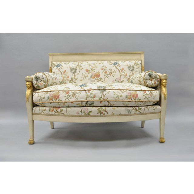 Stunning Early 20th Century French Neoclassical / Empire style figural gold gilt and cream painted settee covered in newer...
