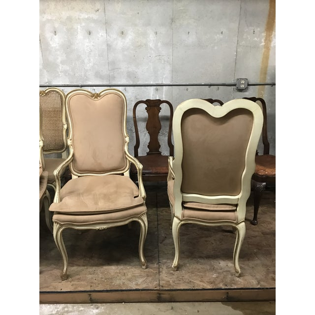 Pink upholstered Louis XV French chairs. Upholstery in great condition on made to look weathered gilt wood.